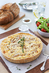 Quiche lunch with green salad and bread