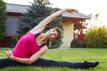 Woman is doing exercises at outdoor