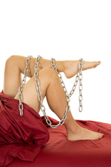 woman legs out of red sheet chain around legs