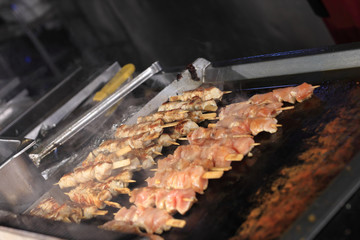 Cooking of kebab on skewers