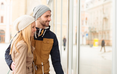 Romantic young couple,looking at shop window