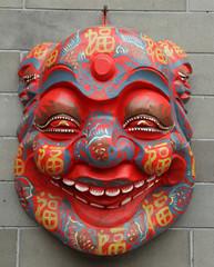 chinese mask on wall on Liulichang street in Beijing