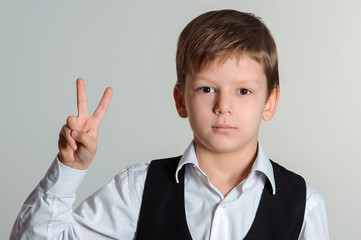 student boy making victory sign