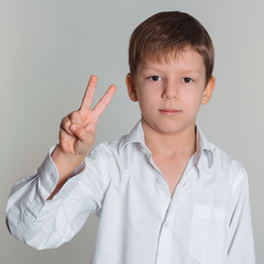 boy making victory sign