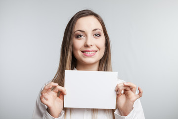 Pretty young girl holding white card
