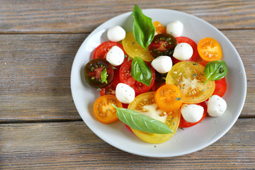 ripe tomatoes with basil and mozzarella