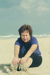 Senior caucasian woman relaxing on the beach