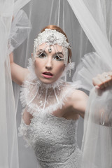 Beautiful woman in white tulle