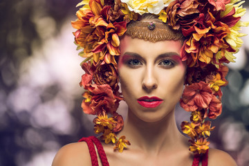 Portrait of a beautiful woman with flowers