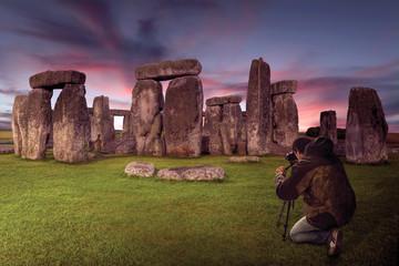 Photographer on the mythical place of Stonehenge
