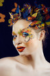 woman with summer creative make up like butterfly closeup