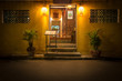 Leinwanddruck Bild - Entry to old cafe at night in Vietnam, Asia.