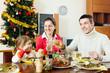 family of three celebrating Christmas