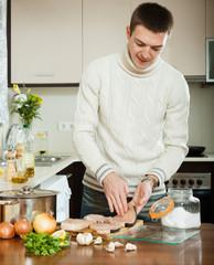 man cooking steak of fish