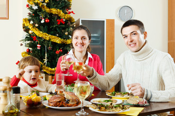 parents and child around festive table at home