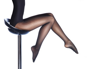 Beautiful legs in nice pantyhose isolated on white