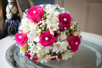 Wedding bouquet with white and pink roses