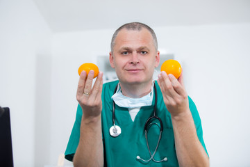 Happy doctor offering you orange