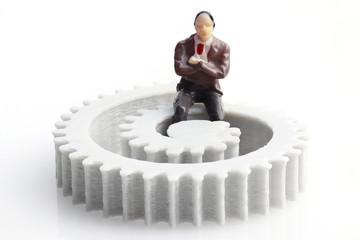 Businessman on the Cogwheel
