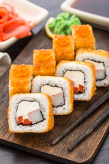 Fried sushi roll with shrimp and caviar