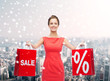 young woman in red dress with shopping bags