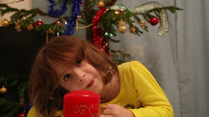 Christmas, celebration, holiday, xmas - cute child blowing on ca