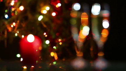 glasses with champagne and candle against christmas lights - rac