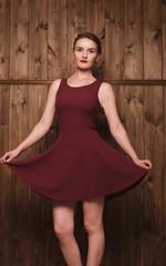 beautiful girl in a burgundy dress