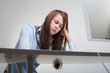 Beautiful woman tired at work