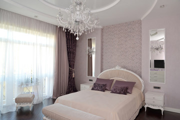 Bedroom in light tones. Modern classics with rococo elements