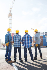group of builders in hardhats outdoors