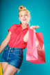 canvas print picture - Pinup girl with shopping bag buying clothes. Sale