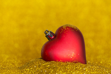 christmas decoration with heart shape and gold background