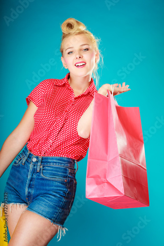 canvas print picture Pinup girl with shopping bag buying clothes. Sale