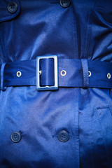 Female fashion. Closeup blue coat wit belt