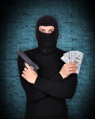terrorist holding gun and dollars