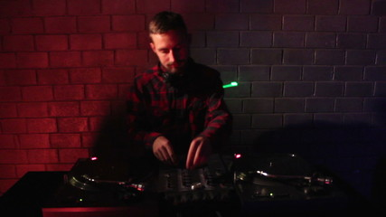 DJ using his mixer and  turntable