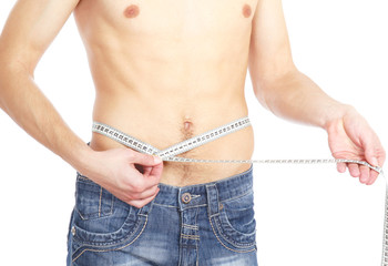A muscular man measuring his waist isolated on white background