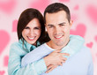 Woman Embracing Man Over Colored Background