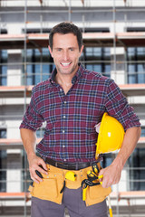 Architect With Hardhat And Tools Against Building