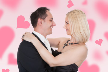 Couple Embracing Amidst Hearts