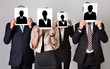 Businesspeople Holding Photographs In Front Of Faces