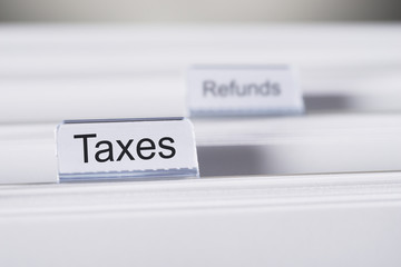 Taxes And Refunds Tabs On Folders
