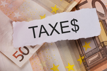 Taxes Sign On Euro Banknotes