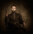 Handsome well-dressed man with walking stick sitting in leather