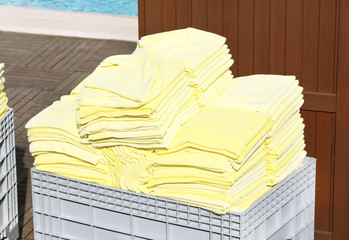 Towels near swimming pool from hotel