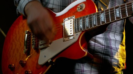 musician plays the electric guitar