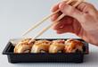 hands sticks japan rolls