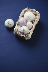 Chinese garlic over dark blue wooden background, high angle view