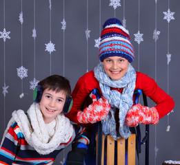 Winter Fashion. Adorable happy kids.